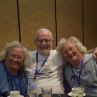 Al Smith surrounds Lauren and Paula Liebrecht