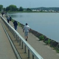 Other members walking along the bridge to get a view of Lynde Point Lighthouse and Saybrooke Breakwater