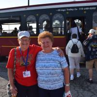 Marge and Pat, her sister, meet before boarding the trolley
