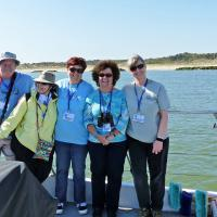 Rick, Kathryn, Debbie, Cheryl & Mary Lee pose with the New Cape Henry Lighthouse in the background.