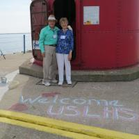Milt and Shirley wait to climb and marvel at our chalk greeting.