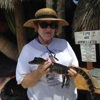 Marjie holding baby Alligator