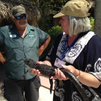 Sue holding Baby Alligator and Pilot Mike
