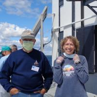 Diane with docent at DeTour Reef Lighthouse