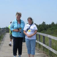 Carole and Pat stop to admire the light at the end of the boardwalk.