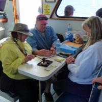 "Our friend James ""Lighthouse"" Hill who has one of the most impressive collections of lighthouse passport stamps around, joined us on the cruise and helped Mary Lee stamp passport books."