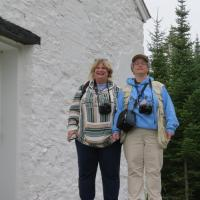 Michelle and Teri scan the horizon from the porch at Rock Harbor Lighthouse.
