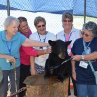 Esther, Wanda, Marge, Marietta and Laurel enjoy feeding MAX his afternoon Cheerios!