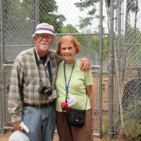 Steve and Nancy stop while walking the grounds of the bear farm.