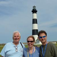 "Executive Director, Jeff and long time Society member Glen, posed with Melissa at Bodie Island.  At the home office, she is known as ""The Commissioner""  leaving no doubt as to who is in charge."