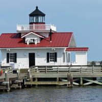 A wonderful replica of the Roanoke Marshes Lighthouse stand at the end of a pier in Manteo, on Roanoke Island.