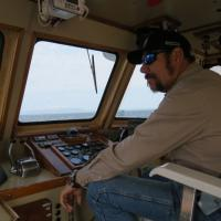 Capt. Don keeps a watchful eye out for our next lighthouse.