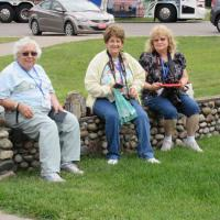 Nina, Norma and Ruth rest on the stone hedge at Point Iroquois.