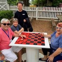 Randall, Toni, Jeff and Joan Playing checkers at Pensacola Lighthouse