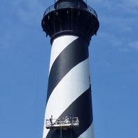 When we visited Cape Hatteras, they were painting the tower using blue painters tape to make sure the stripes were straight