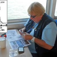 A set of special passport stamps were made for the lights in Buzzards Bay that do not have official Society stamps.  Here Ann works to get them matched up and into her Passport.