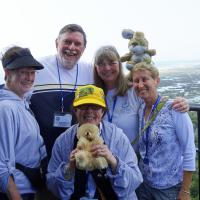 Peggy, Skip, Mary Lee, Jill, Kathryn and mascots atop Cape Hatteras.