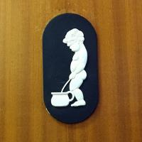 An interesting sign for the men's room - nothing similar for the ladies room!