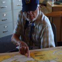 Chuck plots the course along Lake Superior's shoreline.