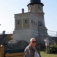 George relaxes in the shadow of the lighthouse.