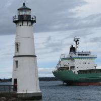 Large ships pass Rock Island on their way to St. Lawrence River or Toronto