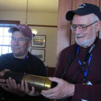 Mark and Al examine a piece of history at Granite Island.