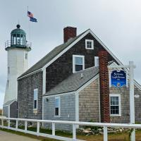 """The Scituate Lighthouse is where two sisters, turned away a British warship and thus was born the legend of Scituate's """"Lighthouse Army of Two."""""""