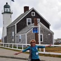 Diane strikes a pose in front of the final lighthouse of the tour.