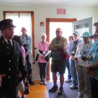 Keeper Fred takes the group on a tour of his living quarters.