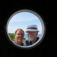 Wanda and Steve are framed perfectly by the round window at Sand Point.