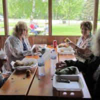 Val, Dimitri, Ruth and Norma get ready to devour lunch in Brimley State Park shelter.
