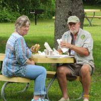 David and Carole prefer the outdoor setting for lunch.