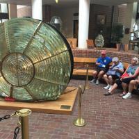 Bill, Dorothy, Sandra and Bill admiring the Clamshell Lens at CG Station