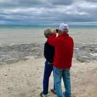 Bill using Barbara as a tripod to take Mohawk Island Lighthouse