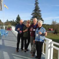 Ned, Diane, Bob and Sandy on the front porch of the Marathon Inn, Grand Manan Island.