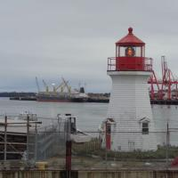 Faux lighthouse with an authentic Fresnel lens located on the Coast Guard base in Saint John, New Brunswick.
