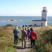 Group heading down the trail to the Quaco Head Lighthouse, New Brunswick