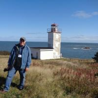 Dave at Quaco Head Light.  Note the rock in the background – that is where the original lighthouse was located many years ago.