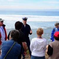 Coast Guard speaking to the group at New Point Loma Lighthouse