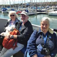 Elinor, Jeremy and Mary relax on the way to the Isle of May.