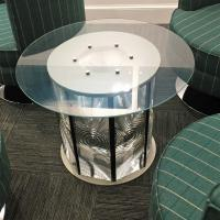Everyone wanted to take one of these Fresnel lens table from the NLB office.