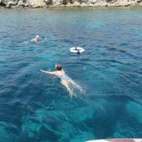 Chris and Janet swimming in the waters of Greece