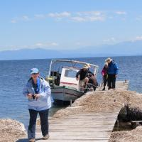 Mary and group getting off the small boat