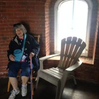Dona taking a moment of reflection inside the Tarrytown Lighthouse
