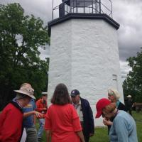 Group gathering in front of the Stony Point Lighthouse