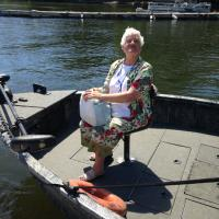 Glenda has the front seat on the boat to Bluff Point