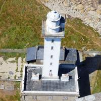 View of the old Ille Vierge lighthouse from the top of the new one.