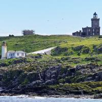 Isle of May High and Low Lighthouses and the what remains of the oldest lighthouse in Scotland. (1636)