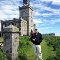 Jeremy poses in front of the Robert Stevenson designed Isle of May Lighthouse