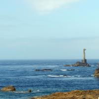 Nividic Lighthouse with German cable towers built to bring electricity to the lighthouse but never completed